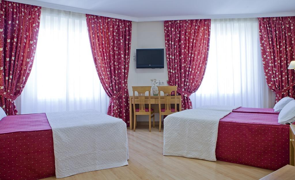 Chambre double avec deux lits supplémentaires