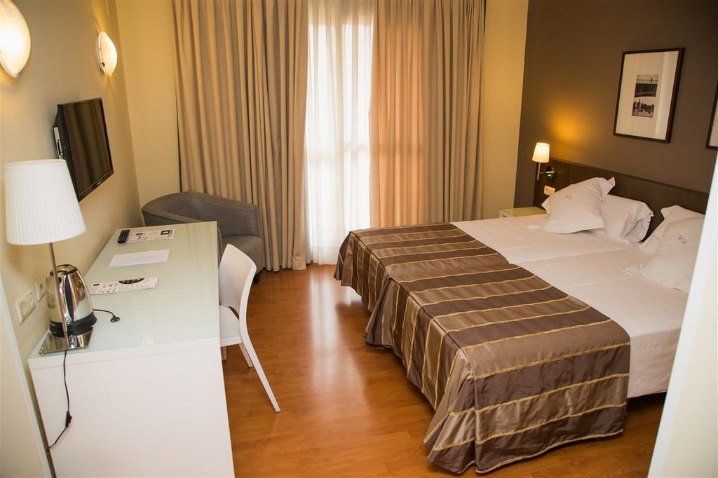 Habitaciones hotel v rtice sevilla web oficial for Hoteles barcelona habitaciones cuadruples