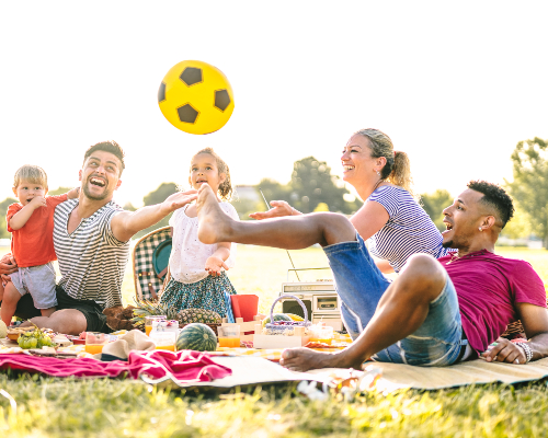 https://images.mirai.com/OFFERS%2FHOTELS%2F100363581%2Fhappy-multiracial-families-having-fun-with-cute-kids-at-pic-nic-garden-party.jpg