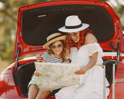 https://images.mirai.com/OFFERS%2FHOTELS%2F100364042%2Flittle-girl-ready-go-vacations-mother-with-daughter-examining-map-traveling-by-car-with-kids.jpg